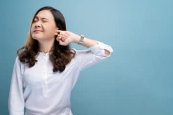woman scratching ear