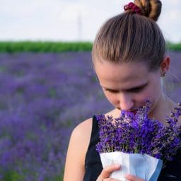 woman smelling a bouquet of lavender