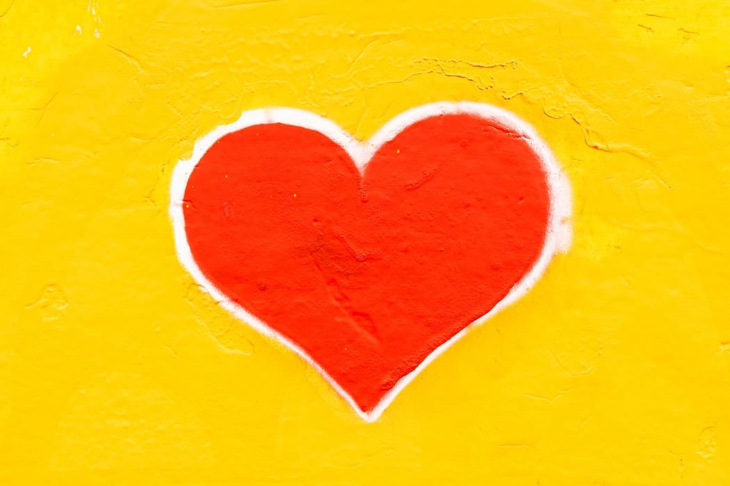A picture of a heart shape on a yellow background.